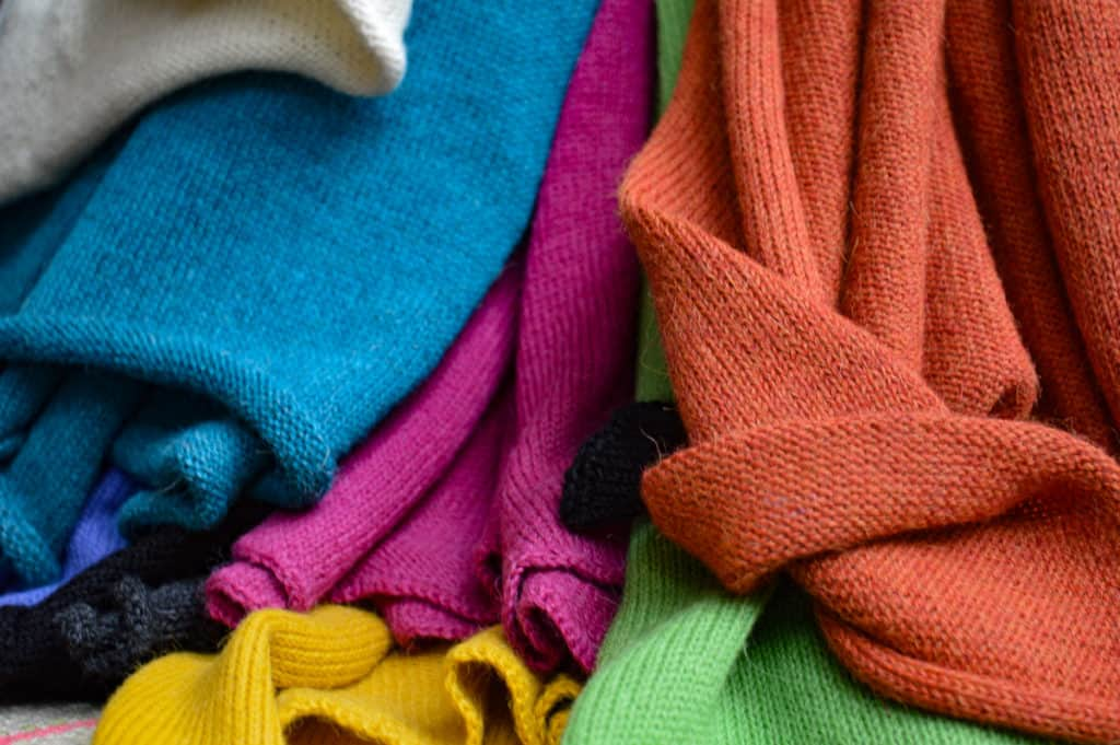 Colorful scarves of 100% alpaca wool. Knitted and shown with label. Blue, pink, green, orang, grey and yellow.
