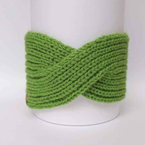Handknitted headband English (fish bone stitch) 100% alpaca. Photographed from the front. Bright green color.